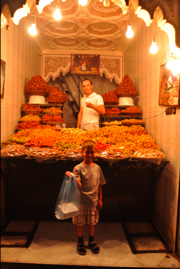 Ben buys baclava in a sweet shop in Marrakesh.